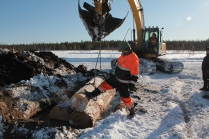 Vanhanmaja wetland Finland, installing water control structure 3 timber side by side2, photo Juha Siekkinen 15.3.2013