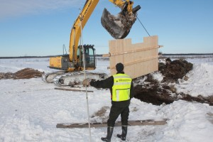 Vanhanmaja wetland Finland, installing water control structure timber headwall, photo Juha Siekkinen 15.3.2013