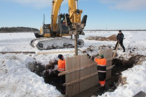 Vanhanmaja wetland Finland, installing water control structure timber headwall2, photo Juha Siekkinen 15.3.2013